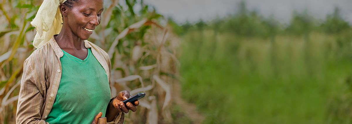 Adasa John receives a phone call in her field in Rudewa Mbuyuni location near Morogoro, Tanzania on May 27, 2014.