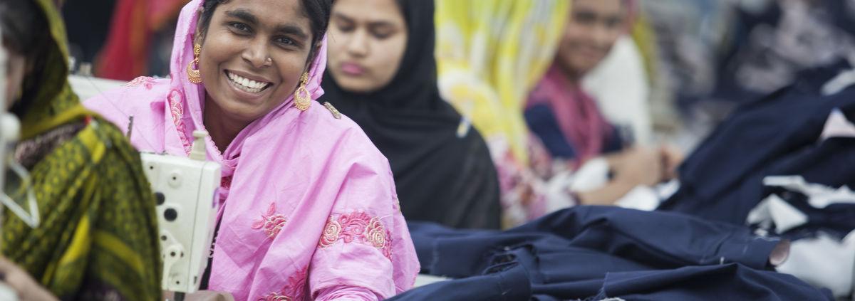 Bangladesh woman in garment factory smiling