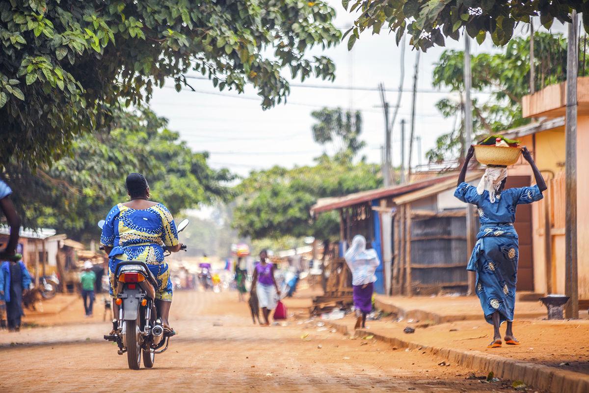 african street scene woman bike