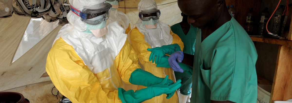 ebola workers in yellow gear and green gloves