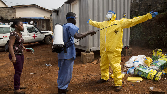 Ebola Worker being sprayed down