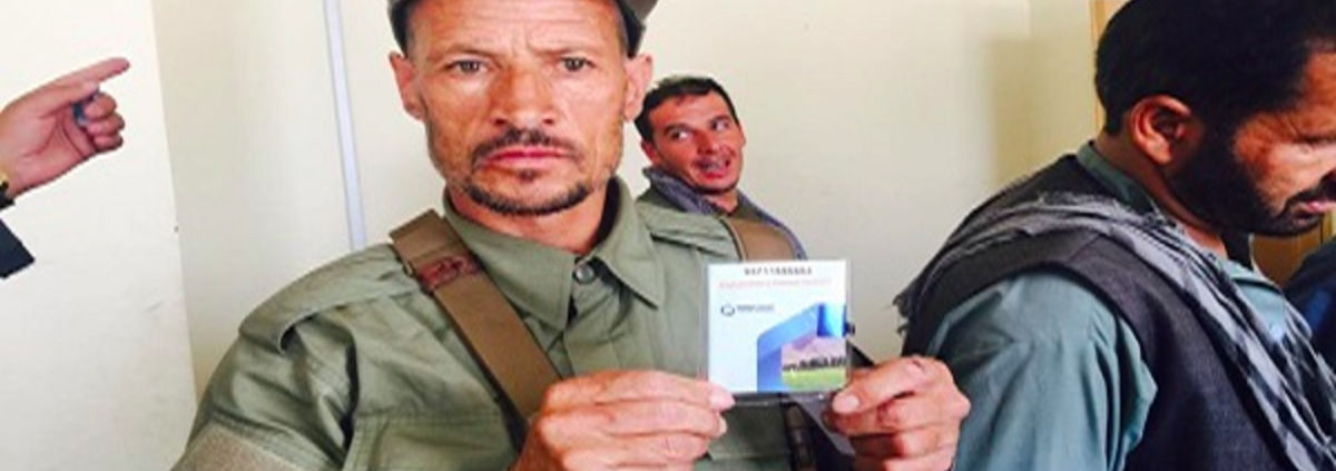 Afghanistan police holding up ID
