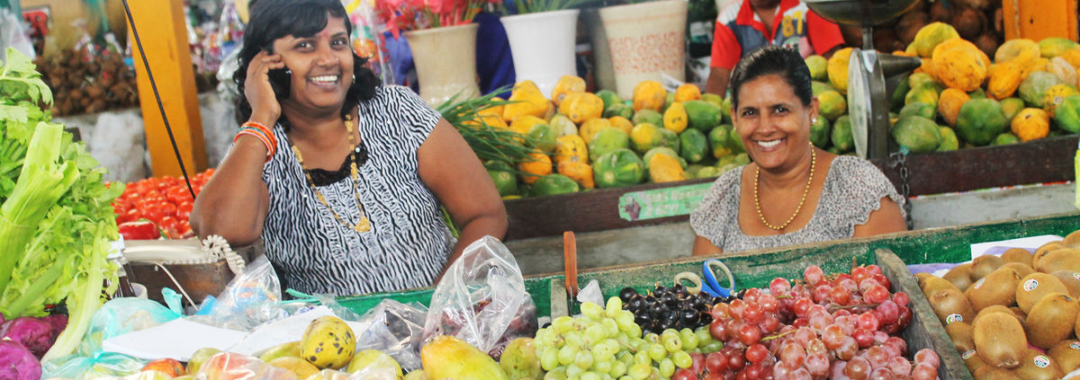 women on phone at market