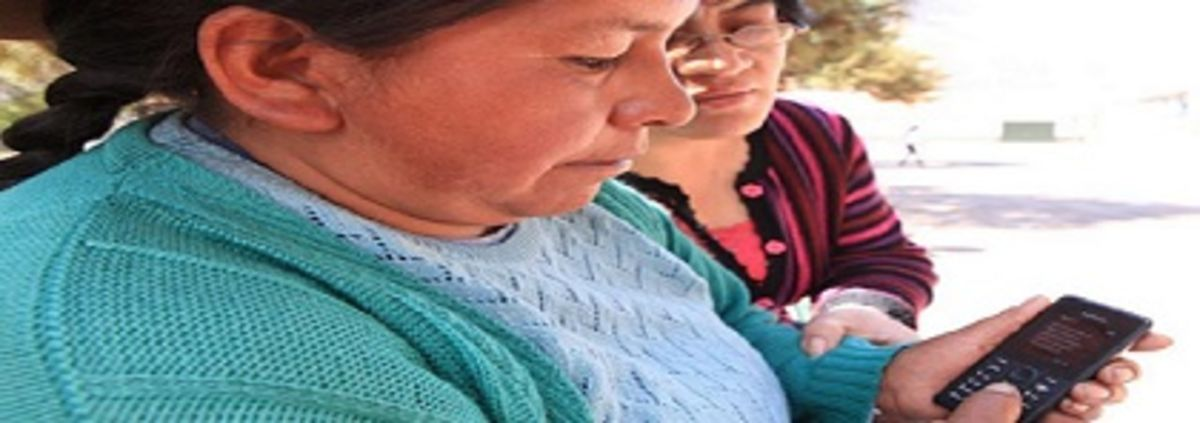 Woman from Peru shows a mobile phone message confirming that her Bim account is up and running.