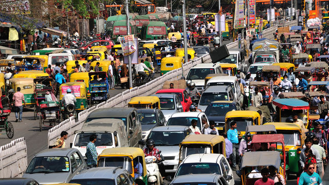 Many cars, auto rickshaws, people cause heavy traffic jam as usual on Chandni Chowk street in Old Delhi