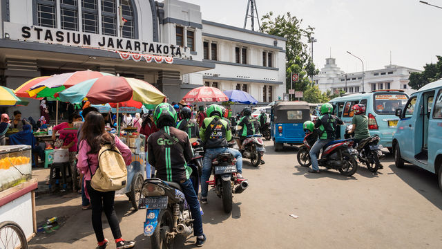 Motorbike taxi drivers in Jakarta that work for Grab and Gojek, ride-sharing apps.