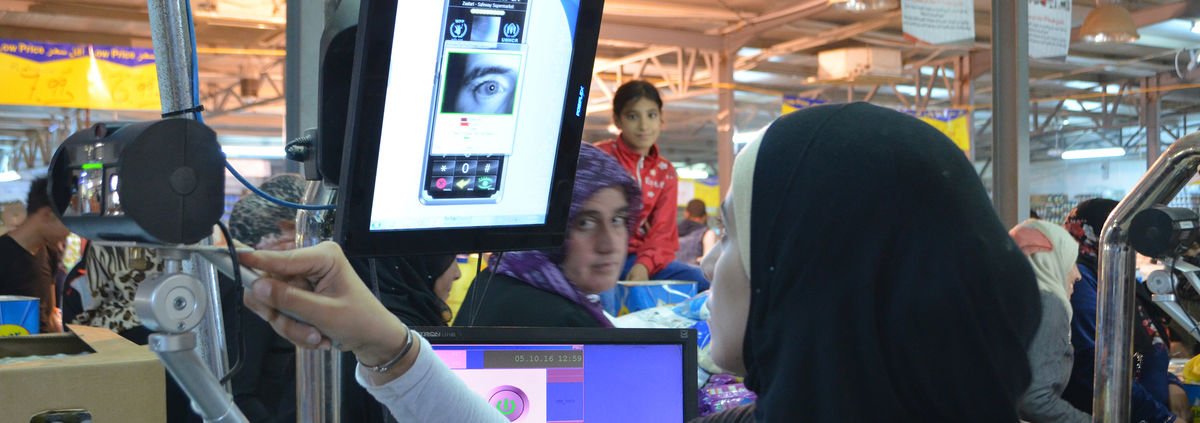 woman using technology to scan eye/facial recognition